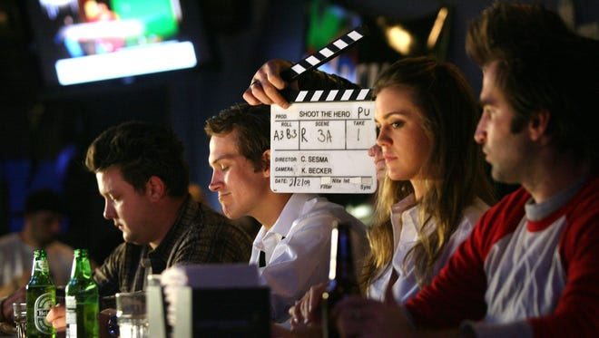 """Filming takes place at the bar at NYPD Pizza for the movie """"Shoot the Hero"""" directed and written by Christian Sesma on Feb. 2, 2009, in Palm Springs. Toni Bakal argues for a new Coachella Valley-based industry to power a revival of musicals."""