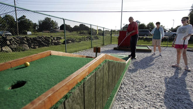In addition to food, the Red Rooster Drive-In offers mini golf.