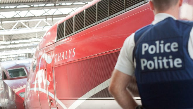 A member of the Belgian police stay next to a Thalys train at the Brussels Midi - Zuid train station, on Saturday, Aug. 22. Security has become more visible after an attack on Friday of a Thalys train traveling from Amsterdam to Paris.