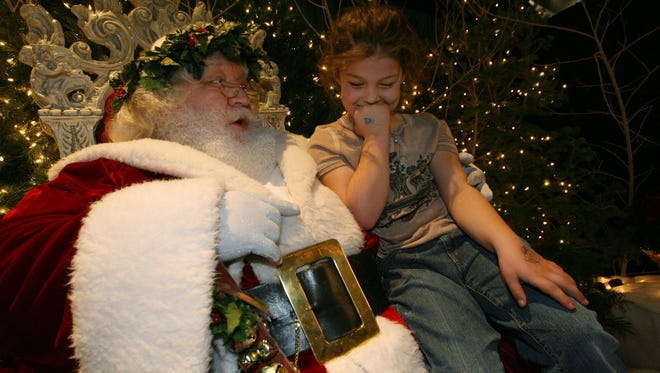 Brooklyn Bott contemplates her wish list as she chats with Father Christmas at the Dickens Festival in St. George in this Spectrum file photo