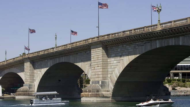 """Boats travel underneath the London Bridge in Lake Havasu City. The city is a finalist for """"America's Best Community."""""""