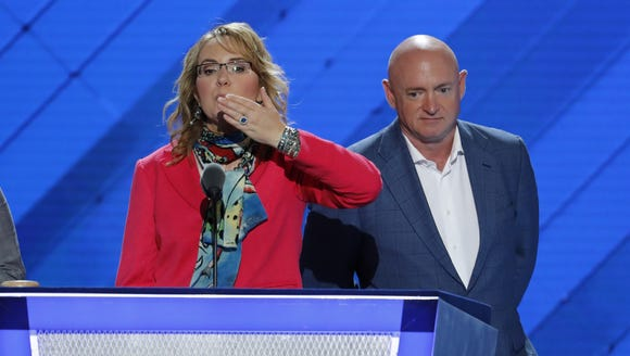 Former Rep. Gabby Giffords, D-Ariz, blows a kiss from