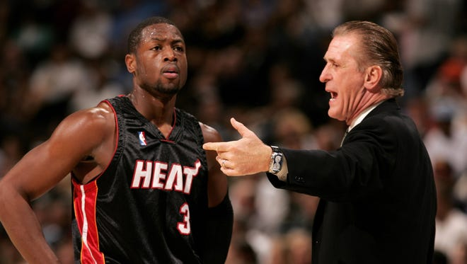 Head coach Pat Riley of the Miami Heat talks with Dwyane Wade #3 as they face the Denver Nuggets on December 8, 2006 at the Pepsi Center in Denver, Colorado.