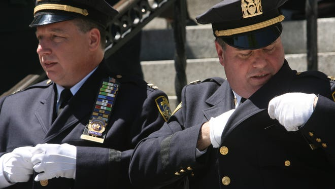 Captain Edward Adinaro, from left, and Captain Roy Hastings after their promotions to captain May 29, 2008, during the Promotions and Designations ceremony of the Mount Vernon Police Department at City hall.