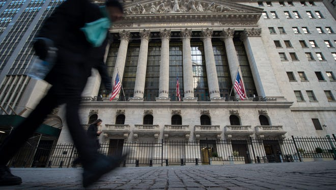 Pedestrians walk past the New York Stock Exchange in New York on Feb. 16, 2017.  beating the consensus forecast for a 180,000 rise, according to payroll services firm ADP.The data come two days before the official US government employment report for February, which analysts expect will show a gain of 188,000 jobs.  / AFP PHOTO / Bryan R. SmithBRYAN R. SMITH/AFP/Getty Images ORIG FILE ID: AFP_MH45W