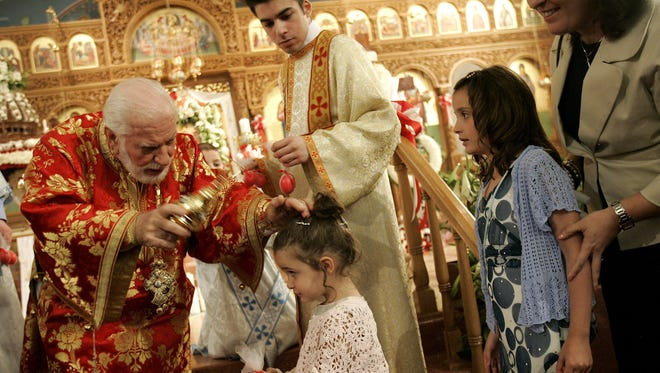 In this April 8, 2007, photo, Metropolitan Iakovos of Chicago blesses people at the altar at St. Demetrios Greek Orthodox Church in Chicago. The funeral for Iakovos, who was the leader of the Greek Orthodox Church in the U.S. Midwest, took plce Friday, June 9, 2017. He died June 2 at age 89.
