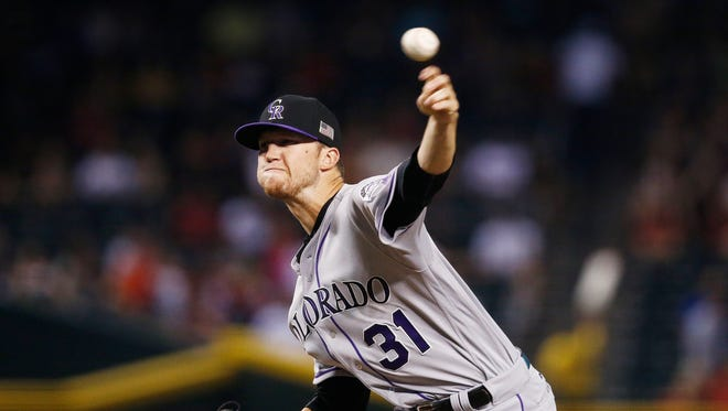 Colorado Rockies' Kyle Freeland throws a pitch against the Arizona Diamondbacks during the first inning of a baseball game, Monday, Sept. 11, 2017, in Phoenix.