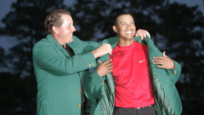 On April 10, 2005, Phil Mickelson helped Tiger Woods into his fourth green jacket.