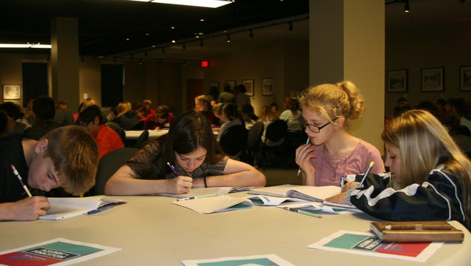 Sixth graders Brandon Koch, Avary Barger, Jamine Quinn, and Kaylee Hood were among the 300 Pinkston Middle School students who attended Tuesday's writing workshop at Arkansas State University-Mountain Home
