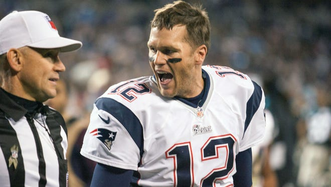 New England Patriots quarterback Tom Brady (12) argues with a referee while walking off the field at Bank of America Stadium. The Panthers defeated the Patriots 24-20.