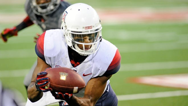 Oct 25, 2014: Arizona Wildcats wide receiver Cayleb Jones (1) makes the grab on the sideline against the Washington State Cougars during the second half at Martin Stadium. The Wildcats beat Cougars 59-37.