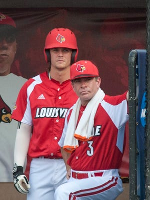 U of L's Devin Mann and University of Louisville head baseball coach Dan McDonnell watch their team's batter in the bottom of the 1st inning during the third day of the NCAA Baseball Louisville Regionals at UofL's Patterson Stadium. 04 June 2017