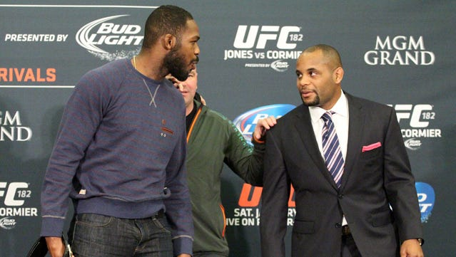 Jon Jones and Daniel Cormier face off at a UFC 182 press conference Thursday in Las Vegas.