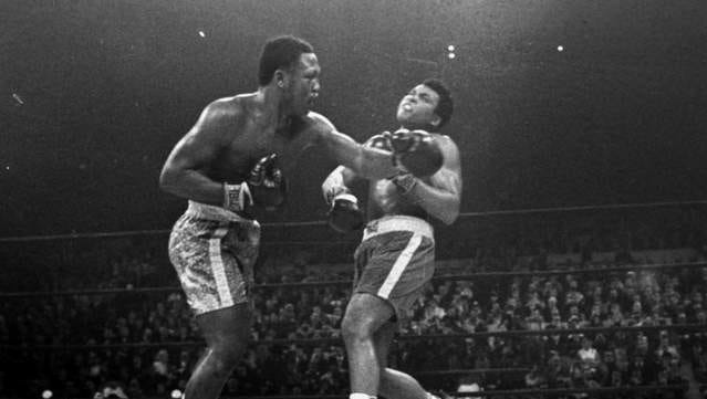 Boxer Joe Frazier, left, hits Muhammad Ali during the 15th round of their heavyweight title fight at New York's Madison Square Garden on March 8, 1971.