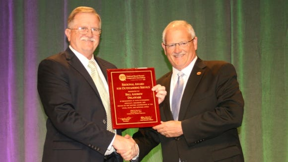 Bill Andrew (left) receives his Outstanding Service Award from Mel Coleman (right)