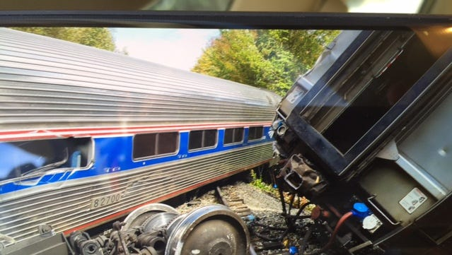 Two cars of an Amtrak train derailed in Northfield Monday morning. The train company said there were no reports of life-threatening injuries. Seven people were transported from the scene.