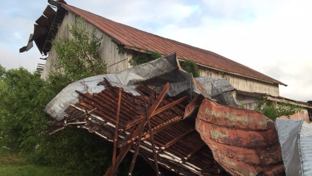 A possible tornado Saturday damaged this barn along Indiana 38 west of Tingler Road northwest of Richmond. Kristie Hetisimer said her family had just sat down for dinner when the storm hit.