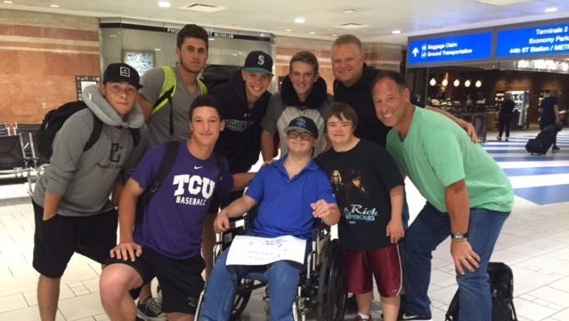 Connor (middle) had a team of baseball players, led by Chaparral senior Jacob Gonzalez (in TCU shirt) and his dad, former  Diamondbacks outfielder Luis (in green shirt), help him get through a rough flight home.