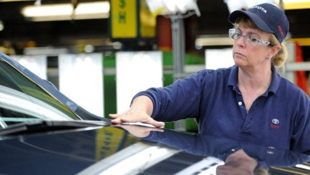 Betty Hyde performs surface inspections on 2012 Toyota Highlander vehicles at the Toyota Motor Manufacturing Indiana, Inc., plant in Princeton, Ind. July 12, 2016.