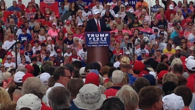 A large crowd listens as Donald Trump speaks at a rally in Lakeland.