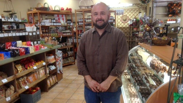 Alex Hernandez recently bought The Coffee Emporium, a unique coffee and gift shop, which   has become a West Side staple in its 35 years in business.