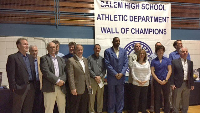 The newest inductees into Salem's Wall of Champions proudly stand at the conclusion of Saturday's ceremony.