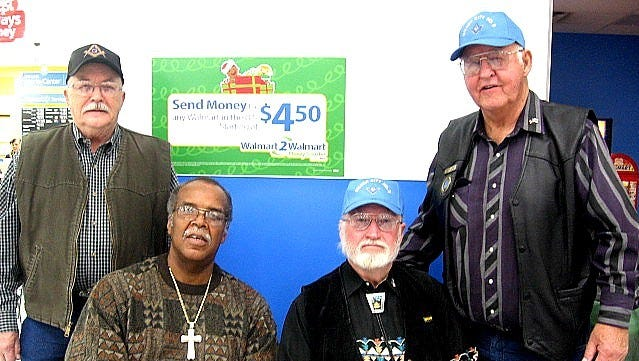 From left, are Val Brahm Santa Rita Lodge representative, Masonic Charities Coordinator Rev. Earseye Ross, Silver City Member Bruce Tolhurst, and Hurley Master Robert Baker pose after the morning shift of helping Grant County children have a better Christmas.