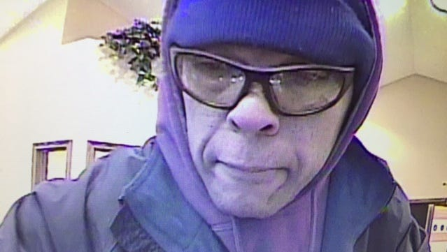 A surveillance camera at the Lafayette Community Bank captured an image of a robbery suspect Saturday morning.