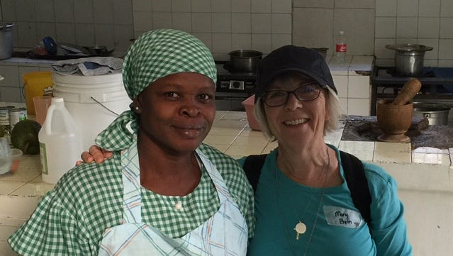 Mary Beth Davis with a local volunteer cook