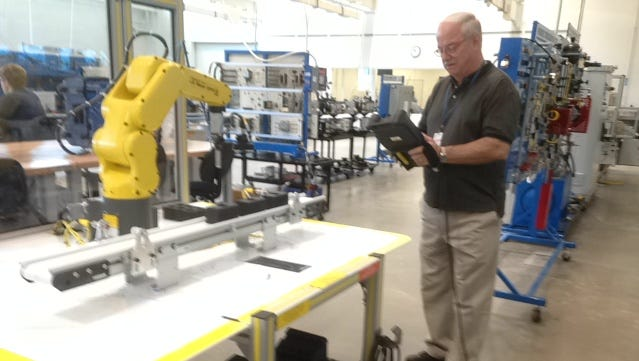Ken Maxwell operates a robot at the College of Applied Technology campus in Smyrna. Maxwell is an industrial maintenance/mechatronics instructor.