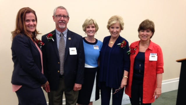 Four local nonprofits were the winners of $100,000 Impact 100 grants in 2017. From left are Shannon Bowman, Childcare Resources of Indian River County; Paul Sexton, Hibiscus Children's Center; Suzanne Bertman, Impact 100 president; Peggy Cunningham, Alzheimer & Parkinson Association of Indian River County; and Edie Widder, Ocean Research & Conservation Association.