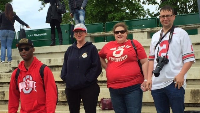 Ohio State fans watch Michigan's practice in Rome on Thursday.