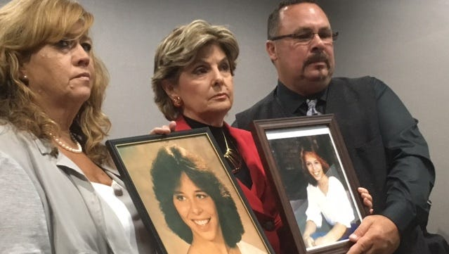Gloria Allred (center), Cindy Arndt and Mark Borowski hold up photos of Lorry Ann Borowski, one of 20 women who authorities believe were killed by the satanic cult known as the Ripper Crew. One  member of the cult, Thomas Kokoraleis, is expected to be paroled soon after spending 35 years in prison for the murder of Borowski.