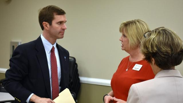 Attorney General Andy Beshear chats with Union County School Superintendent Patricia Sheffer.