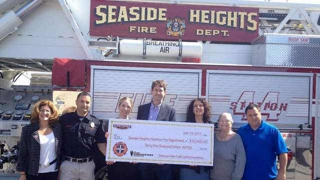 Seaside Heights City Council members, Leary Firefighter Foundation representatives and Firehouse Subs Public Safety Foundation Executive Director Robin Peters stand in front of department fire truck.