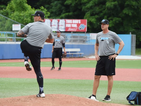 Renegades' Nick Padilla, left, winds up for a pitch