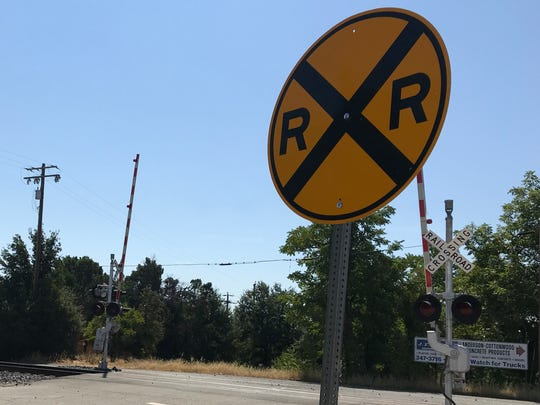 Two Amtrak trains have collided with stolen vehicles that have been left on the tracks at this Cottonwood crossing.