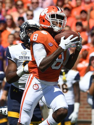 Clemson wide receiver Deon Cain (8) catches a 61 yard TD pass from quarterback Kelly Bryant (2) against Kent Sate during the 1st quarter on Saturday, September 2, 2017 at Clemson's Memorial Stadium.