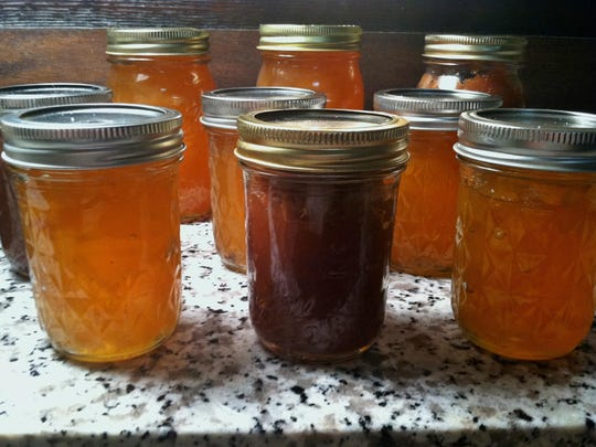 jars of pear preserves and apple butter