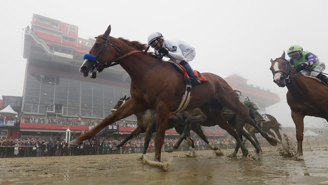 Justify with Mike Smith atop wins the the 143rd Preakness Stakes horse race at Pimlico race course, Saturday, May 19, 2018, in Baltimore.