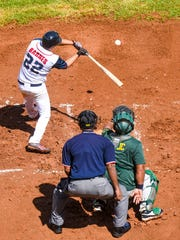 The Guam Men's National Team and Team Kosrae swing it out on the field during Micronesian Classic Goodwill Baseball Tournament action at the Paseo Stadium in Hagåtña on Thursday, Nov. 16, 2017.
