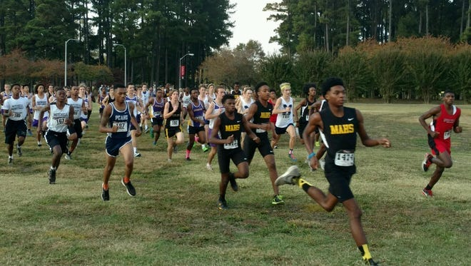 An early moment in the Region 8 A-AA boys cross country race.