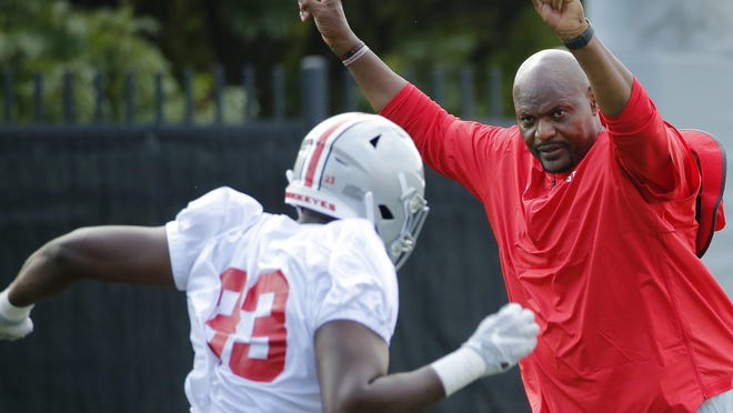 Associate head coach Larry Johnson directs Ohio State Buckeyes defensive end Zach Harrison (33) during football practice at the Woody Hayes Athletic Center in Columbus on Friday, Aug. 2, 2019.