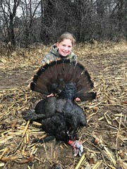 Brenna Holtz, 10, of Wales, poses with a wild turkey she shot while hunting with her father, Andrew Holtz, during the 2018 Wisconsin youth turkey hunt. The bird was taken in Jefferson County.