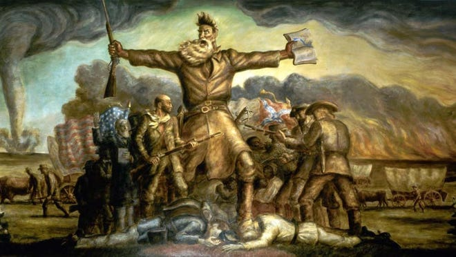 Radical abolitionist John Brown holds a rifle in one hand and a Bible in the other in this mural, which adorns the interior of the Kansas Statehouse.