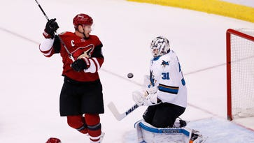 Arizona Coyotes Shane Doan watches the puck bounce off the chest of San Jose Sharks goalie Martin Jones in the first period on Jan. 21, 2016 in Glendale, Ariz.