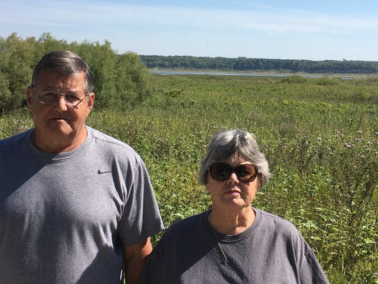 Dan and Alice Catalfo stand in the watershed between
