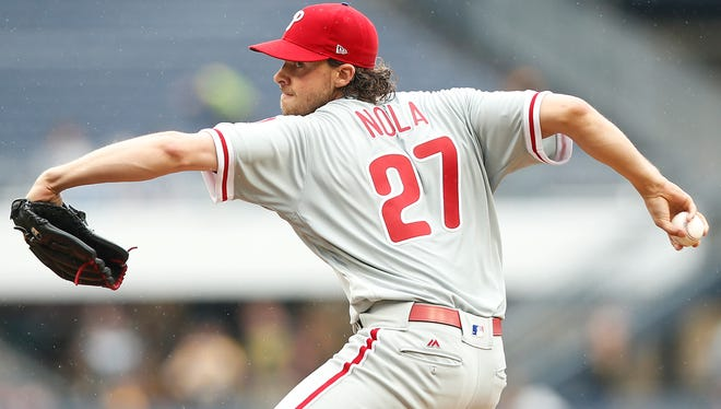 Philadelphia Phillies starting pitcher Aaron Nola (27) pitches against the Pittsburgh Pirates during a baseball game in Pittsburgh, Sunday, May 21, 2017.