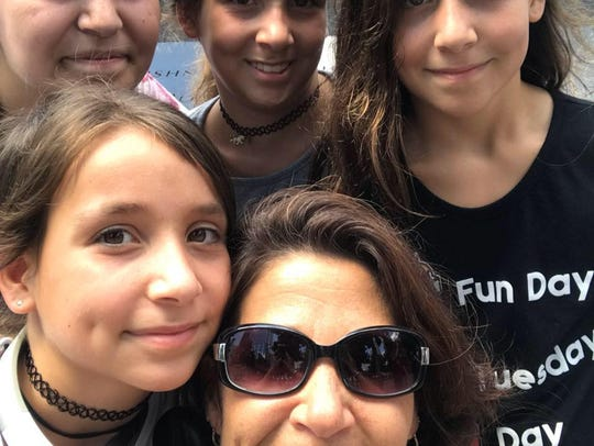Charlene Orsi, bottom center, is shown with her daughters