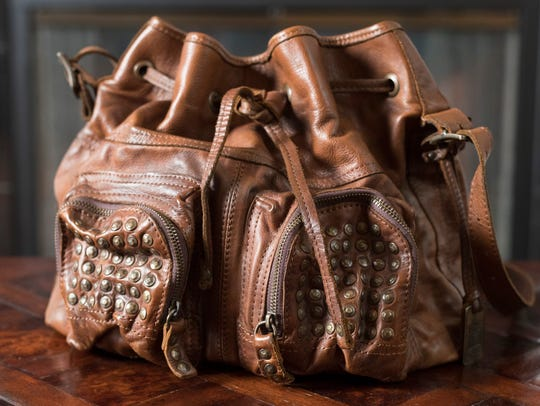 Amanda Hiner's Frye brown leather purse goes well with